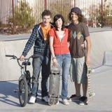 Three teens at skatepark. Three kids hang out at the skatepark Stock Photography