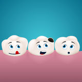 Three teeth look at the hole in one of them Stock Images