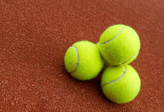 Three tennis ball on the court Royalty Free Stock Image