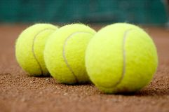 Three tennis balls. Middle tennis ball in focus Royalty Free Stock Images