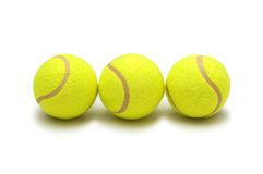 Three tennis balls isolated Royalty Free Stock Images