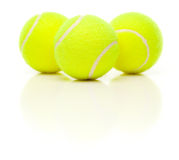 Three Tennis Balls on White with Slight Reflection Royalty Free Stock Image