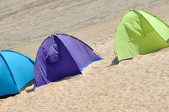Three tent on sand. Tent in different color on sand, shown as seaside enjoy in summer and holiday life royalty free stock image