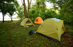 Three tents near ocean in Panama Stock Photo