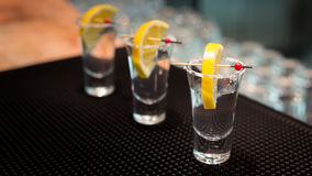 Three tequila shots with lemon Stock Photos