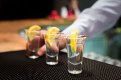 Three tequila shots with lemon Stock Photography