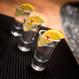 Three tequila shots with lemon Royalty Free Stock Photography