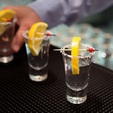 Three tequila shots with lemon Stock Image