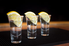 Three tequila shots with lemon Stock Images