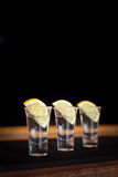 Three tequila shots with lemon Royalty Free Stock Photo