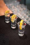 Three tequila shots with lemon Royalty Free Stock Photos