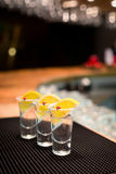 Three tequila shots with lemon Stock Photo