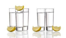 Three tequila shots with lime isolated. Three  tequila shots with lime isolated on white background royalty free stock image