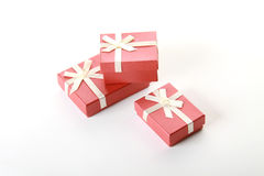 Three terracotta festive boxes over white Stock Image