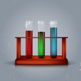 Three test tubes in wooden box Royalty Free Stock Images