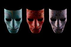 Three textured AI robotic face masks royalty free stock images