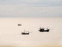 Three thai fisherman boat in the sea Royalty Free Stock Photo