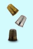 Three thimbles Stock Images