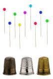 Three thimbles with pins Stock Photo
