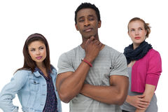 Three thoughtful young people Royalty Free Stock Image