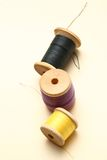 Three thread bobbins Stock Images