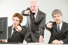 Three thrilled businessmen pointing out to you Royalty Free Stock Images