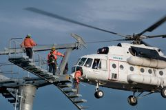 Free Three Thumping Assemblers Under The Helicopter Royalty Free Stock Photography - 97859197