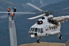 Free Three Thumping Assemblers Under The Helicopter Royalty Free Stock Image - 97859226