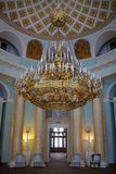 Three-Tier Gilded Chandelier in Oval Room - The Grand Palace in. ARKHANGELSKOYE ESTATE, MOSCOW REGION, RUSSIA. Interior of the Grand Palace - Oval Room— stock photography