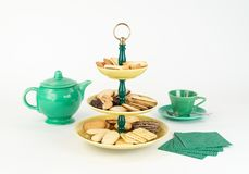 Mid-Century Modern Three Tier Server Tray with an Assortment of Cookies and Tea Pot. royalty free stock image