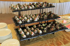 Three tier tray of chocolate dipped berries Royalty Free Stock Photography