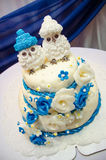 Three tiered blue and white wedding cake with confectionery roses Royalty Free Stock Photos