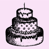 Three-tiered cake with candle Royalty Free Stock Photography