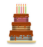Three-tiered chocolate cake with candles. Striped three-tiered chocolate cake with candles on a white background Stock Photography