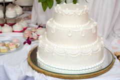 Three tiered wedding cake Stock Photos