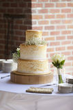 Three tiered wedding cake at reception royalty free stock photography