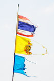 Three time-worn flags Stock Image