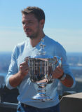 Three times Grand Slam champion Stanislas Wawrinka of Switzerland posing with US Open trophy on the Top of the Rock Observation De Royalty Free Stock Photography