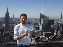 Three times Grand Slam champion Stanislas Wawrinka of Switzerland posing with US Open trophy on the Top of the Rock Observation De Royalty Free Stock Images