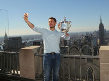 Three times Grand Slam champion Stanislas Wawrinka of Switzerland takes selfie with US Open trophy on the Top of the Rock Stock Image