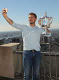 Three times Grand Slam champion Stanislas Wawrinka of Switzerland takes selfie with US Open trophy on the Top of the Rock Royalty Free Stock Photo