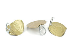 Three tin can lids with opener Royalty Free Stock Images