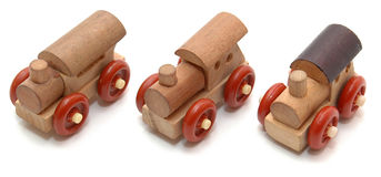 Three tiny trucks. Three tiny wooden trucks or locomotives. Can be cut out separately, everything is in focus Stock Image