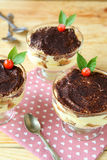 Three tiramisu dessert on wooden table Royalty Free Stock Photography