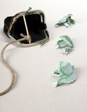 Three toads from one hundred euro banknotes catch with purse. Soft focus Stock Image