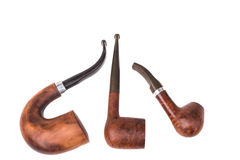 Three tobacco pipes Stock Photography
