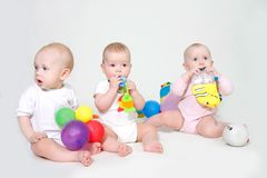 Three toddlers, studio shot Stock Image