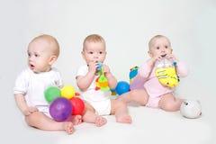 Three toddlers, studio shot Stock Image