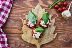 Three Tomato Dishes on Brown Wooden Chopping Board royalty free stock photography