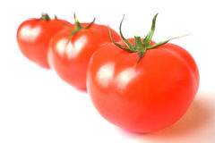 Three tomatoes-02. A photo of a three tomatoes Royalty Free Stock Photo
